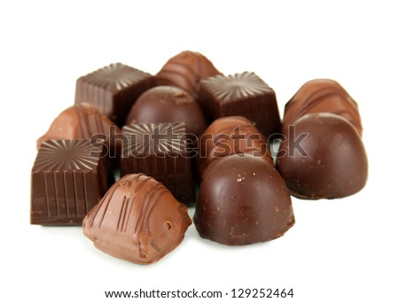 Chocolate sweets isolated on white - stock photo