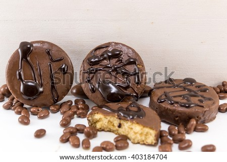 chocolate syrup cookies on white - stock photo