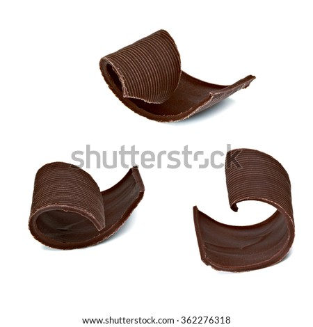 Chocolate tablets with curls on white background  - stock photo