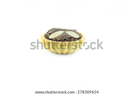 Chocolate tart with almonds on white background. - stock photo