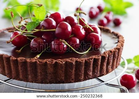 Chocolate tart with fresh cherry. - stock photo