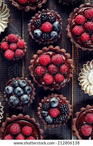 Chocolate tartlets with raspberries, blueberries and blackberries - stock photo