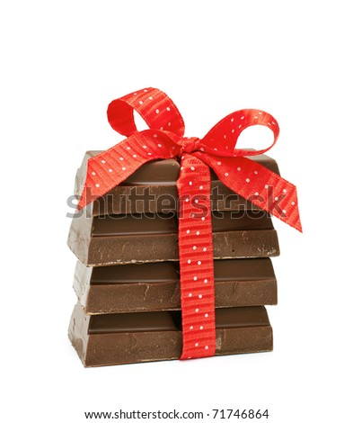 chocolate tied with a red bow - stock photo
