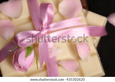 Chocolate tied with pink ribbon, close up