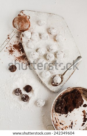 Chocolate truffles cookies on white wooden background. Step on step. Rustic style - stock photo