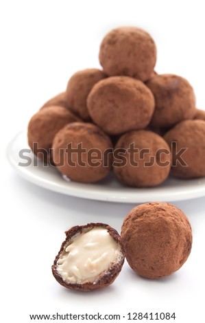 Chocolate truffles with sweet cream inside on the white background - stock photo