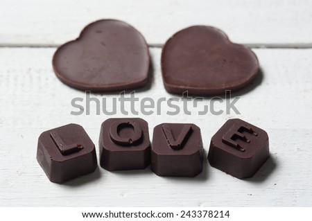 chocolate Valentine's on rusty wooden - stock photo