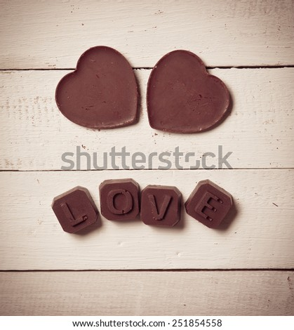 chocolate Valentine's on rusty wooden,vintage color toned image - stock photo