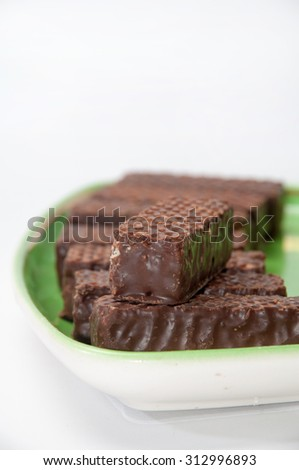 Chocolate wafer arranged on a plate.