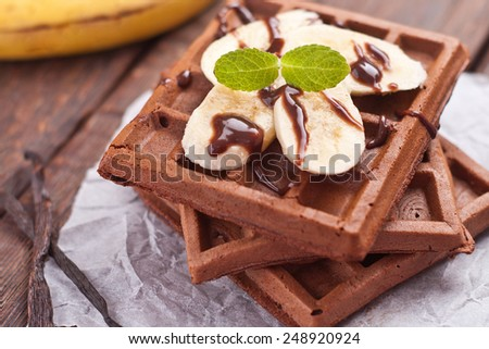 Chocolate Waffle witch banana and chocolate sauce - stock photo
