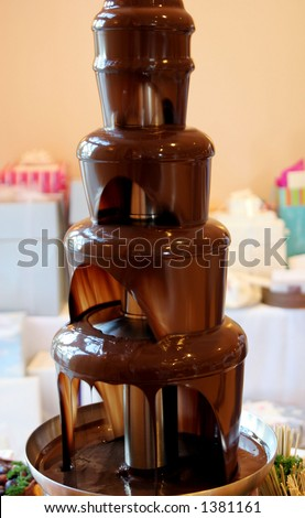 Chocolate wedding fountain. - stock photo
