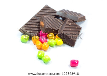 Chocolate with chewing gum on a white background - stock photo