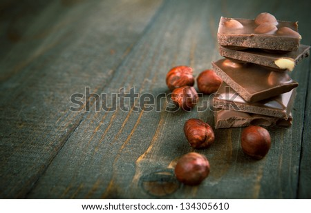 chocolate with hazelnuts - copy space - stock photo