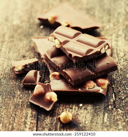 chocolate with hazelnuts - copy space - stock photo