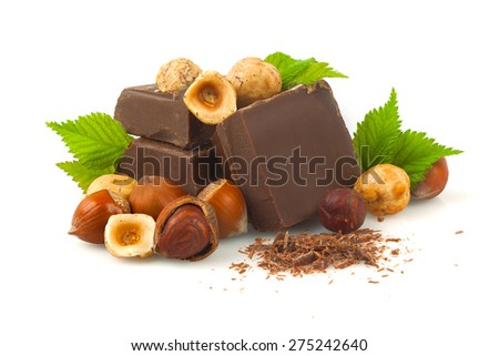 Chocolate with hazelnuts on a white background. - stock photo