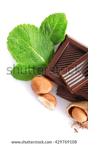 Chocolate with mint and hazelnuts on white background - stock photo