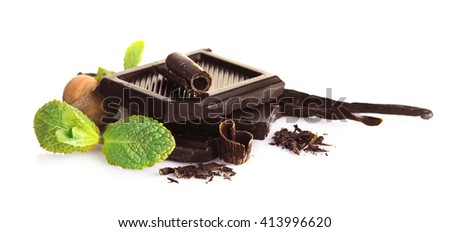 Chocolate with mint and nuts on white background - stock photo