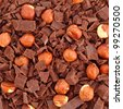 Chocolate with nuts and apricots background - stock photo