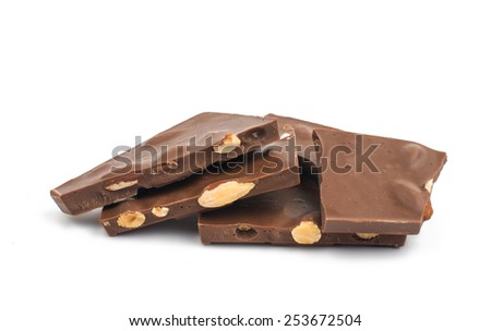 chocolate with nuts on a white background - stock photo