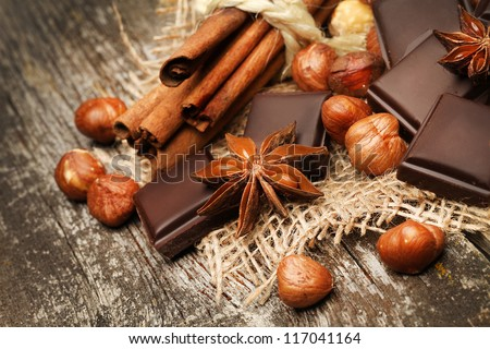 chocolate with nuts on the wooden background - stock photo