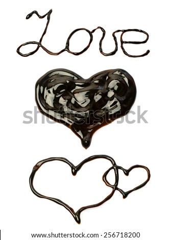 """Chocolate word """"love"""" and heart isolated on white - stock photo"""