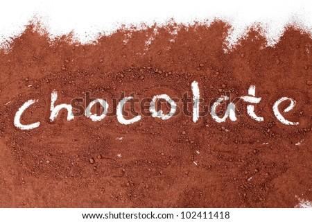 Chocolate written in cocoa powder - stock photo