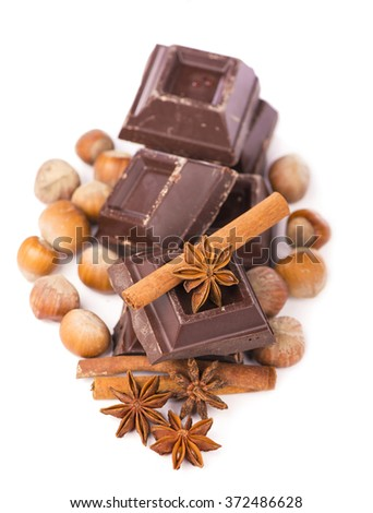 chocolates and spices on a white background - stock photo
