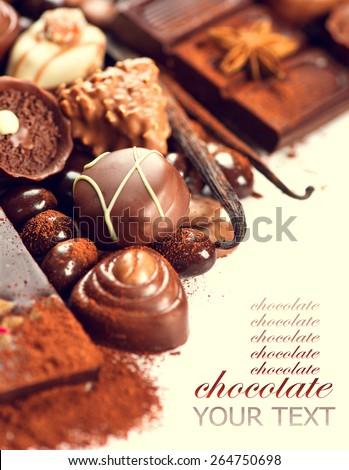 Chocolates border. Chocolate. Assortment of fine chocolates in white, dark, and milk chocolate. Variety of Praline Chocolate sweets - stock photo