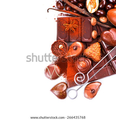 Chocolates border isolated on white background. Chocolate sweets. Assortment of fine chocolates in white, dark, and milk chocolate. Variety of Praline Chocolate candies - stock photo