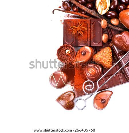 Chocolates border isolated on white background. Chocolate sweets. Assortment of fine chocolates in white, dark, and milk chocolate. Variety of Praline Chocolate candies - stock photo