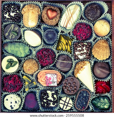 Chocolates Candy. Cross process toned - stock photo