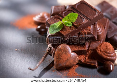 Chocolates. Chocolate. Assortment of fine chocolates in white, dark, and milk chocolate. Variety of Praline Chocolate sweets - stock photo