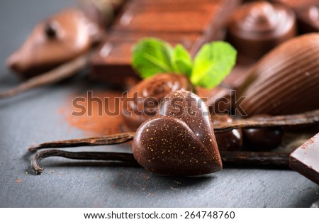 Chocolates. Chocolate. Assortment of fine chocolates in white, dark, and milk chocolate. Variety of Praline Chocolate sweets - stock photo