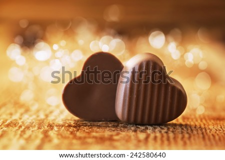 chocolates hearts on a wooden background,  valentines day  - stock photo