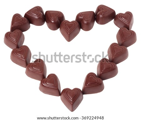chocolates in a heart shape isolated on white background. - stock photo
