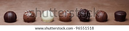 chocolates in a row - stock photo