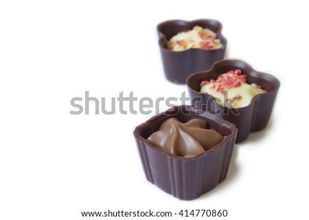 Chocolates isolated on a white background - stock photo
