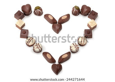 chocolates of different shapes, built in the form of a heart - stock photo