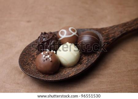 chocolates on a spoon - stock photo