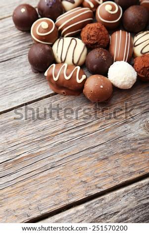 Chocolates on grey wooden background - stock photo