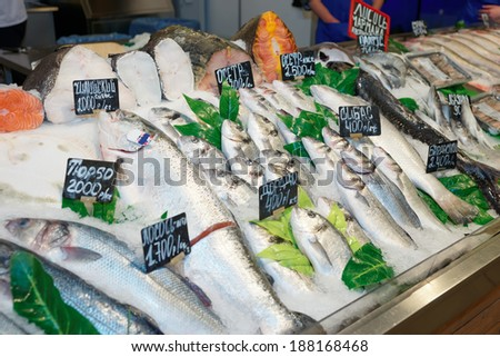 Choic�e of fish on a market display, labels contain no trademarks - stock photo