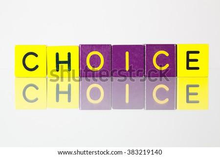 Choice - an inscription from children's wooden blocks - stock photo