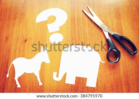 Choice between Democrats and Republicans in the elections. Conceptual image with paper scrapbooking - stock photo