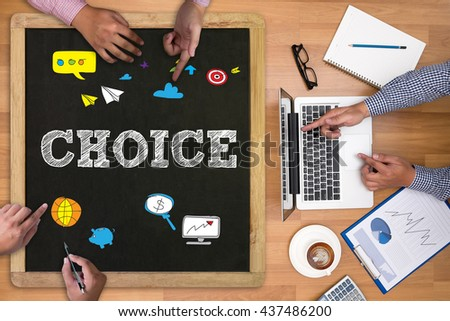 CHOICE Businessman working at office desk and using computer and objects on the right, coffee,  top view, - stock photo