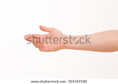 Choice cocept. Adult male hand reaching to pick up something with chess player grip isolated on white background. - stock photo