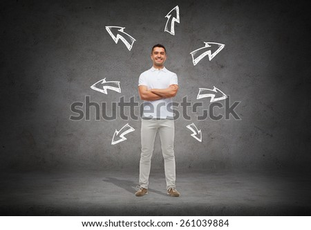 choice, direction, possibilities and people concept - smiling man in white t-shirt with crossed arms over arrow doodles and concrete background - stock photo