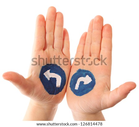 Choice. Hands with the drawn traffic signs as a designator of turn - stock photo
