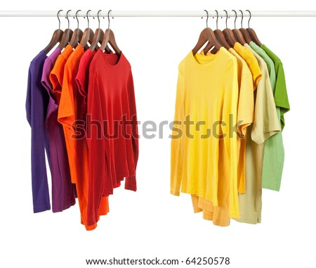 Choice of clothes of different colors on wooden hangers, isolated on white. - stock photo