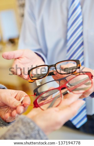 Choice of different glasses at the optician - stock photo
