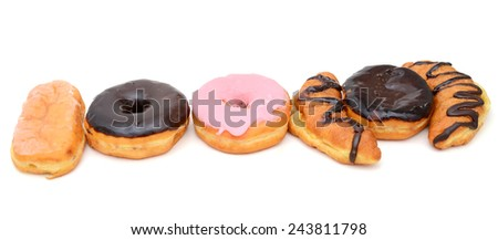Choice of pastry against a white background - stock photo